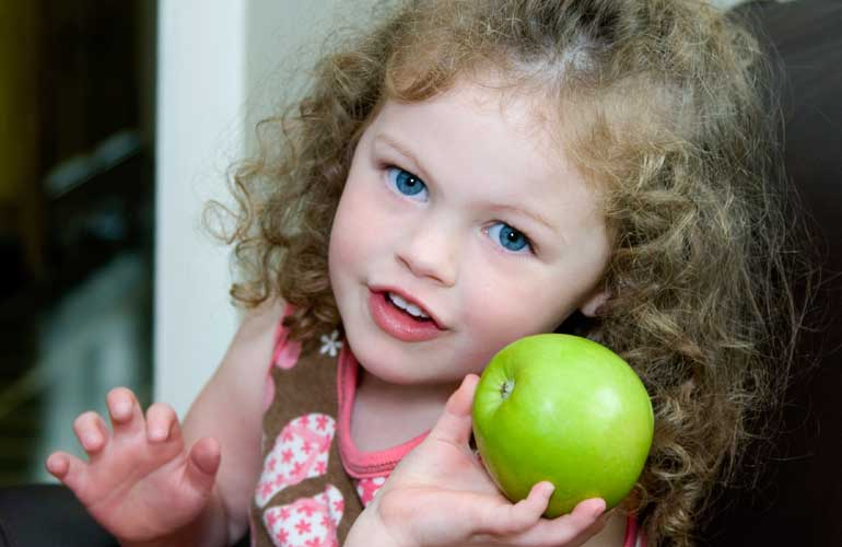 Child with apple.